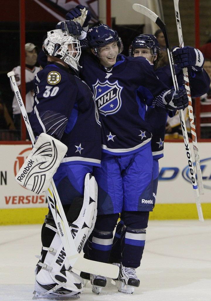 Boston's Tim Thomas, left, and Colorado's Matt Duchene celebrate Team Lidstrom's 11-10 win over Team Staal in the NHL All-Star game on Sunday. Thomas is the first goalie to earn the win in three straight All-Star games.