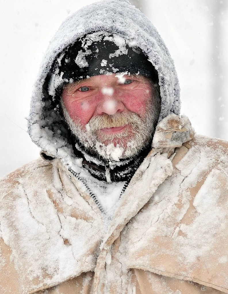 WELCOME TO MAINE: Bob Marden's face, beard and clothes are covered with snow while walking in Watervillle during Wednesday snowstorm.