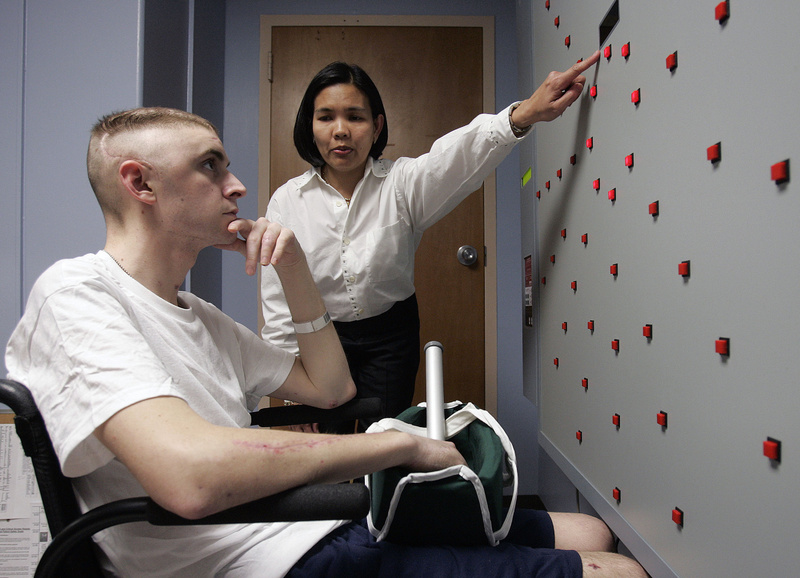 A service member injured in Iraq works with an occupational therapist at the James A. Haley Veterans Hospital in Tampa, Fla., in 2007. U.S. health care systems are fragmented, with care provided by Medicare, Medicaid, the VA, Tricare and private insurance. In many other countries, everybody is in the same system, providing an incentive to see that the system is adequately funded and efficiently run.