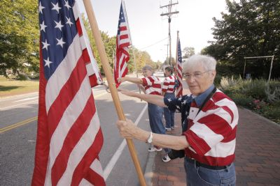 JoAnn Miller, Elaine Greene and Carmen Footer, front to back, known collectively as the Freeport Flag Ladies, wave to passing motorists on Main Street in Freeport on Tuesday, August 31, 2010. The three women have met for an hour every Tuesday since September 11, 2001.