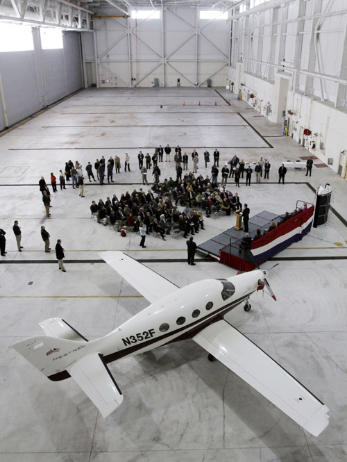 A ceremony at the Brunswick Naval Air Station today marks the beginning of the process of redevelopment of the recently closed Navy property. Kestrel Aircraft Company, one of its planes seen in the foreground, will begin production and operations soon on the site. The former Navy facility will be renamed Brunswick Executive Airport.