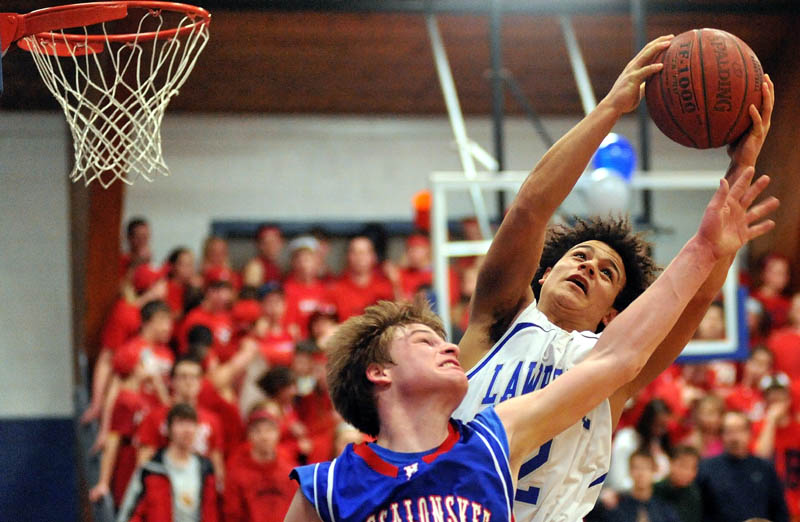 CRASH THE BOARDS: Lawrence's Shaun Carroll, right, fights for the rebound with Messalonskee's Gage Landry in the second quarter of their game Thursday night at Lawrence High School in Fairfield.