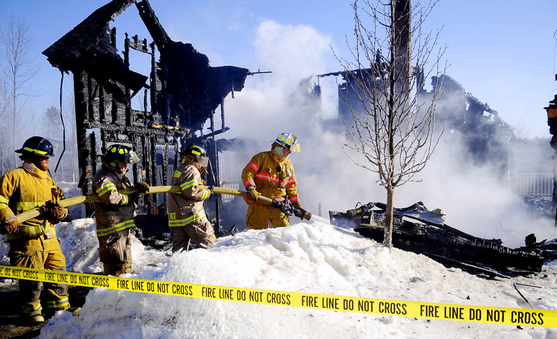 Firefighters extinguish a blaze in Readfield Wednesday that destroyed a home on Church Road.