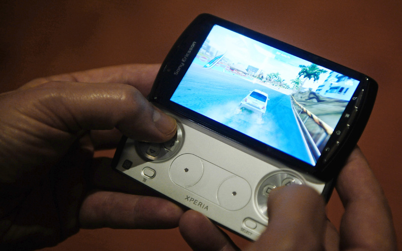 A new mobile phone by Sony Ericcson has a slide-out control pad that mimics that of a PlayStation Portable.