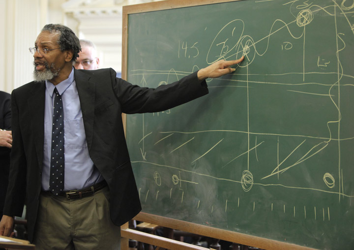 Rory Holland points to a diagram he drew on a chalkboard while arguing for a motion for acquittal during his sentencing in York County Superior Court in Alfred on Monday. Justice Roland Cole denied Holland's motion and sentenced him to life in prison on both counts of murder.