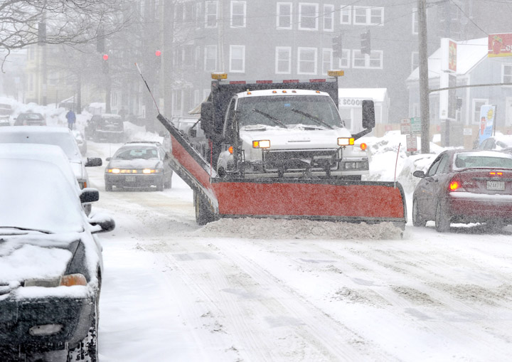 Plows are out today in Portland – seen here on Cumberland Avenue – trying to clear streets ahead of a heavy snow predicted to begin early Wednesday morning.
