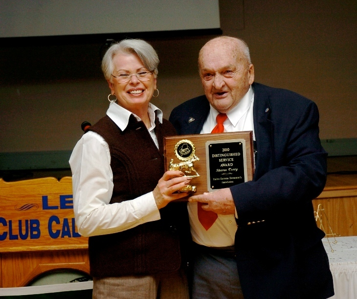 Sharon Terry, president and owner of Scarborough Downs, received the Sheridan Smith Distinguished Service Award at the Maine Harness Horsemen's Association annual banquet held Jan. 22 at The Calumet Club in Augusta. Smith presented the award.