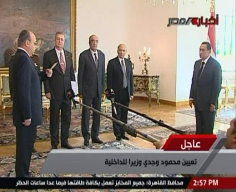 In an image taken from Egypt State TV, President Hosni Mubarak, right, swears in new Interior Minister Mahmoud Wagdi, front left. Mubarak has replaced the Cabinet that was dissolved as a concession to anti-government protests. The U.S. rejected Mubarak's announcement of a new government that dropped his highly unpopular interior minister.