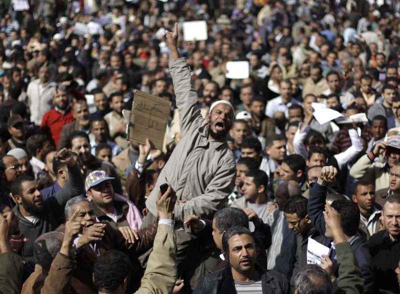 Demonstrators vent their anger Monday in Cairo. A coalition of opposition groups called for one million people to take to the streets today to pressure President Hosni Mubarak to leave.