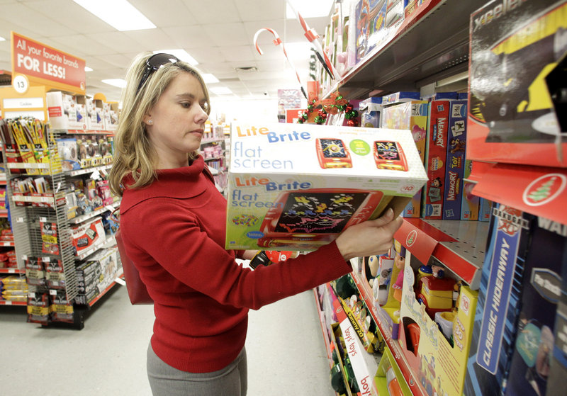 Carrie Marable of Waco, Texas, shops for a holiday gift at the local Family Dollar store in December. Retailers' holiday sales jumped 5.5 percent for the best performance in five years, according to MasterCard Advisors' SpendingPulse.