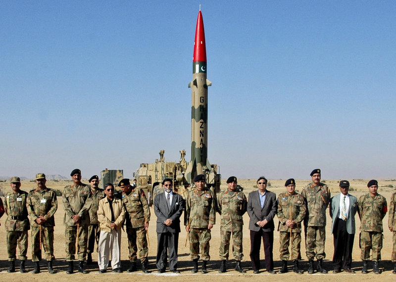 Civilian and military officials from Pakistan stand in front of a short-range Ghazanvi missile prior to a successful test firing in 2008. The missile, which has a range of 180 miles, is capable of carrying a nuclear device.