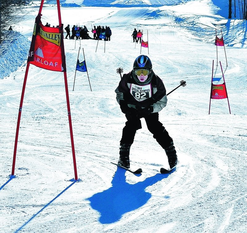 Ben Conant of Creative Trails of Support Solutions in Lewiston competes in the Super G alpine races during the Special Olympics Maine Winter Games at Sugarloaf on Monday.