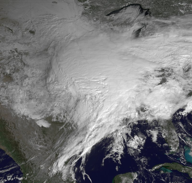 The Associated Press A NOAA satellite photo shows most of the U.S. under cloud cover from the winter storm moving across the U.S. Tuesday. The system stretched more than 2,000 miles.