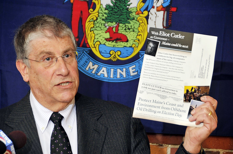Independent gubernatorial candidate Eliot Cutler, shown in an Oct. 25, 2010, photo, holds a mailer that he cited as an example of negative campaigning.
