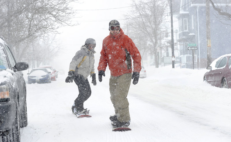 No plows were desired by two hardy boarders Wednesday, as Steve Bailey of Windham and James MacKenzie cruise down Congress Street in Portland during the height of the snowstorm.