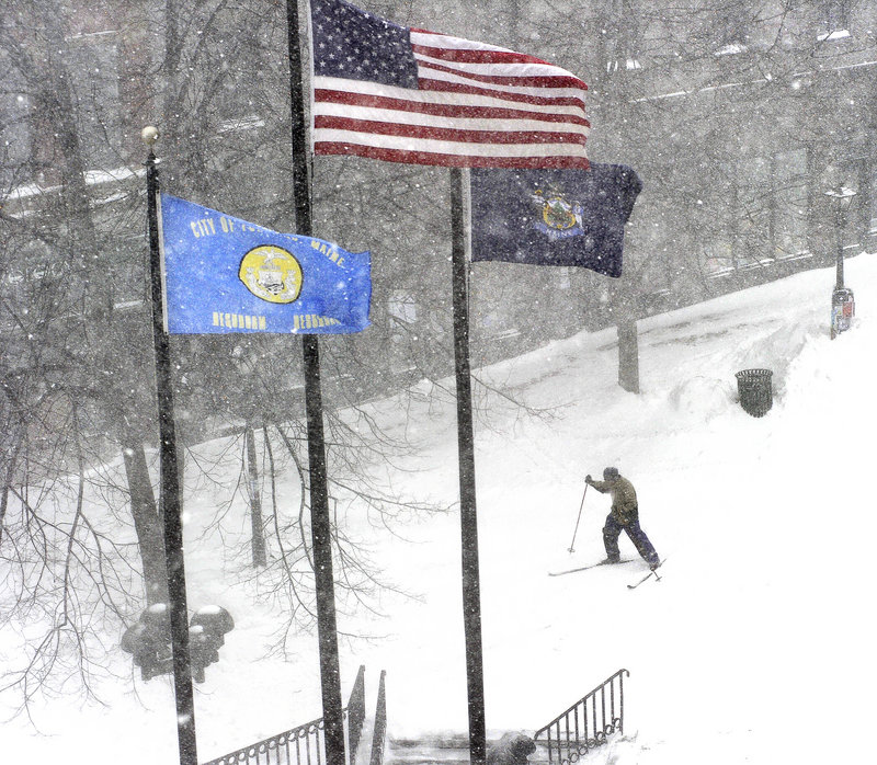 Cross-country skis were a logical form of transportation Wednesday as the snow piled up in Portland's Monument Square.