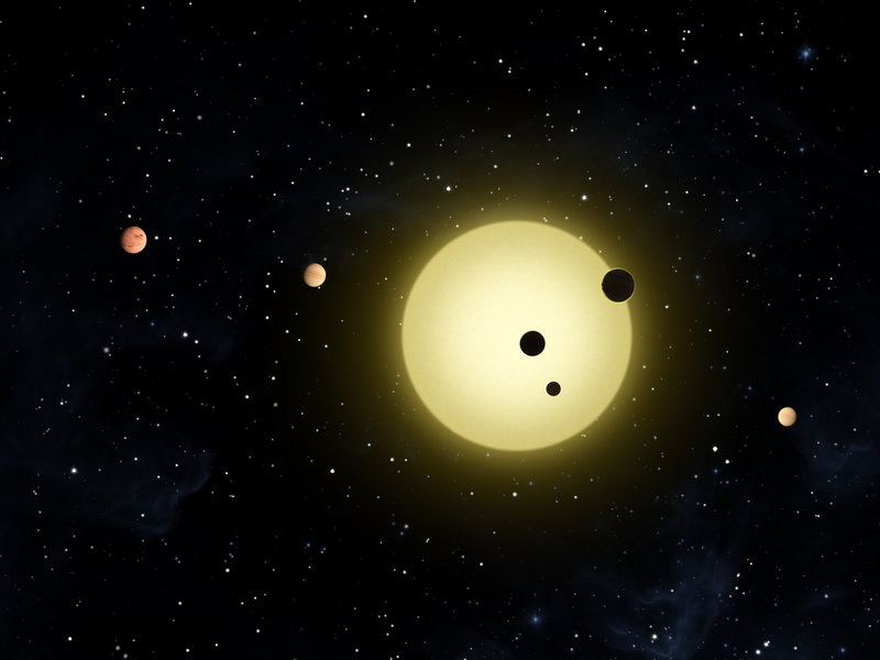 An artist's rendering provided by NASA shows Kepler-11, a sun-like star around which six planets orbit. The planet-hunting Kepler telescope has found 1,235 possible planets during its first year in orbit – 54 of which appear to be in possibly life-friendly zones.