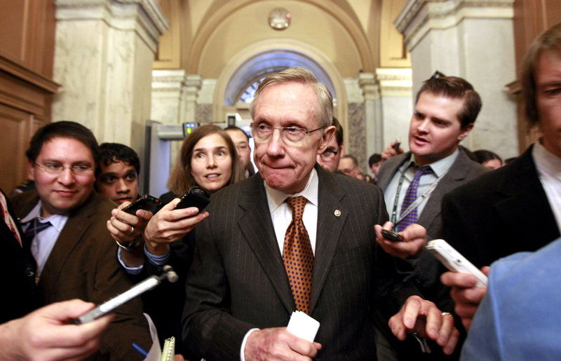 Senate Majority Leader Harry Reid of Nevada is pursued by reporters on Capitol Hill in Washington on Thursday, after a news conference to discuss deficit reduction.