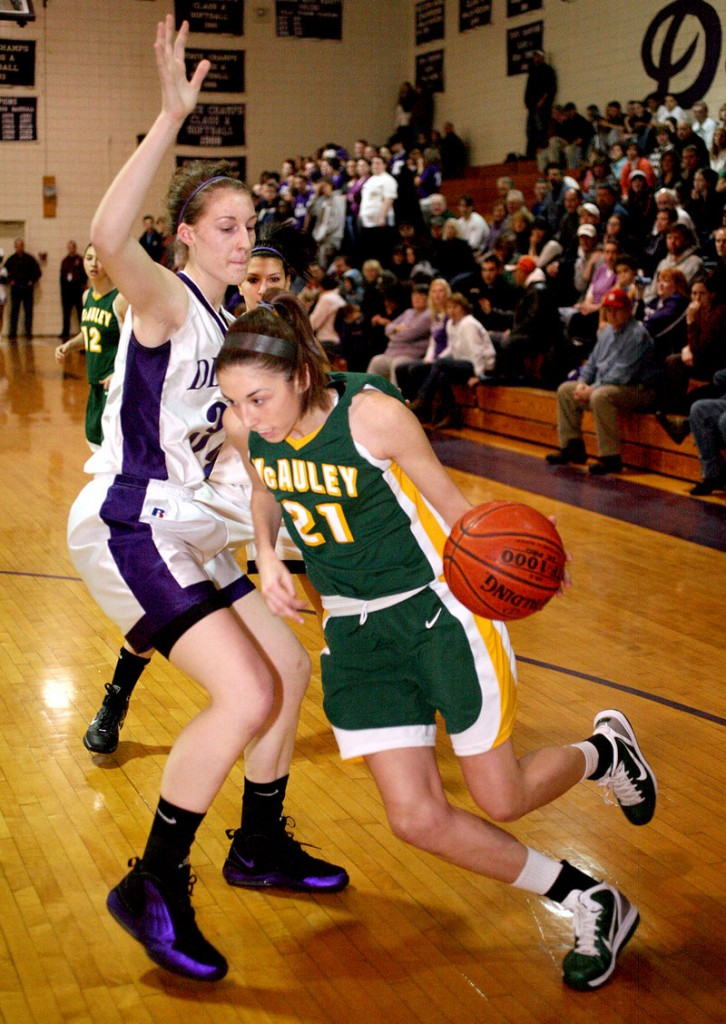 Alexa Coulombe of McAuley heads to the baseline Thursday night while attempting to drive past Marissa MacMillan of Deering during undefeated McAuley's 47-43 overtime victory.