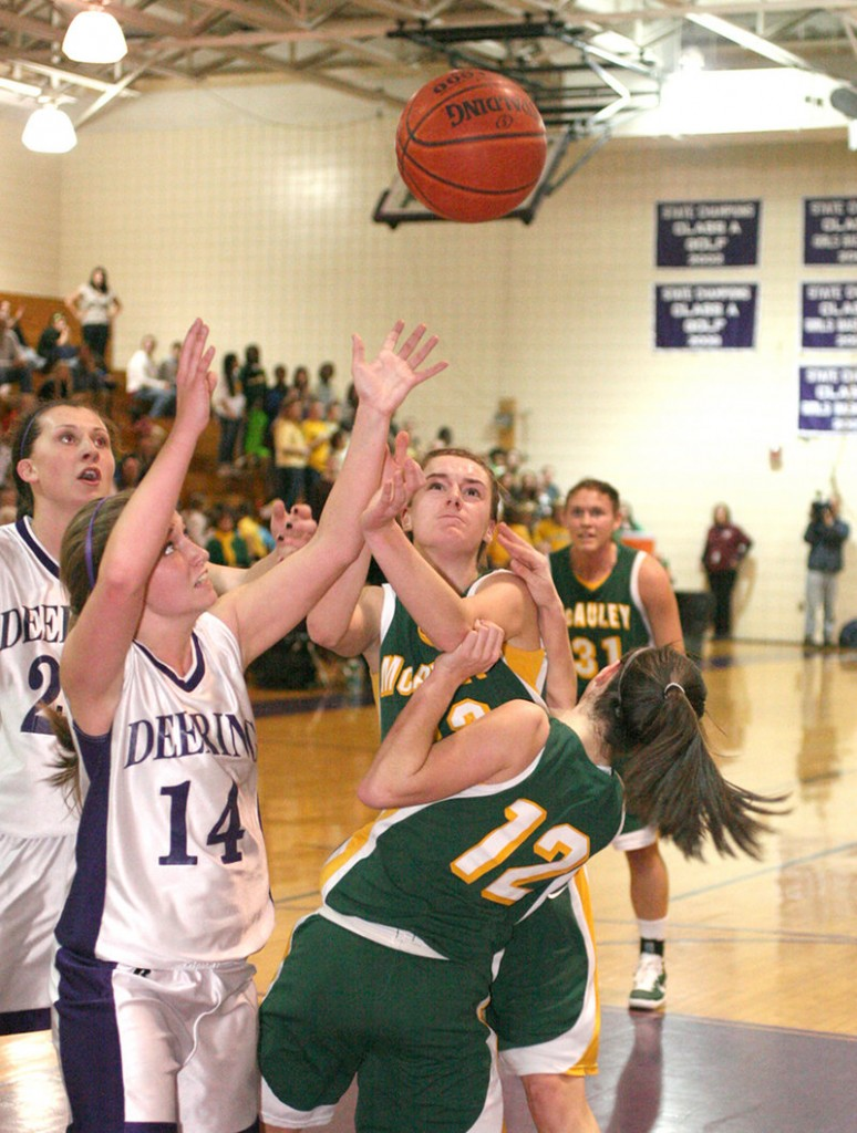 The rebound's coming down and the players converge Thursday night. Emily Cole of Deering, 14, goes for it with Allie Clement, middle, and Sadie DiPierro, 12, of McAuley. Ella Ramonas of Deering is at left.