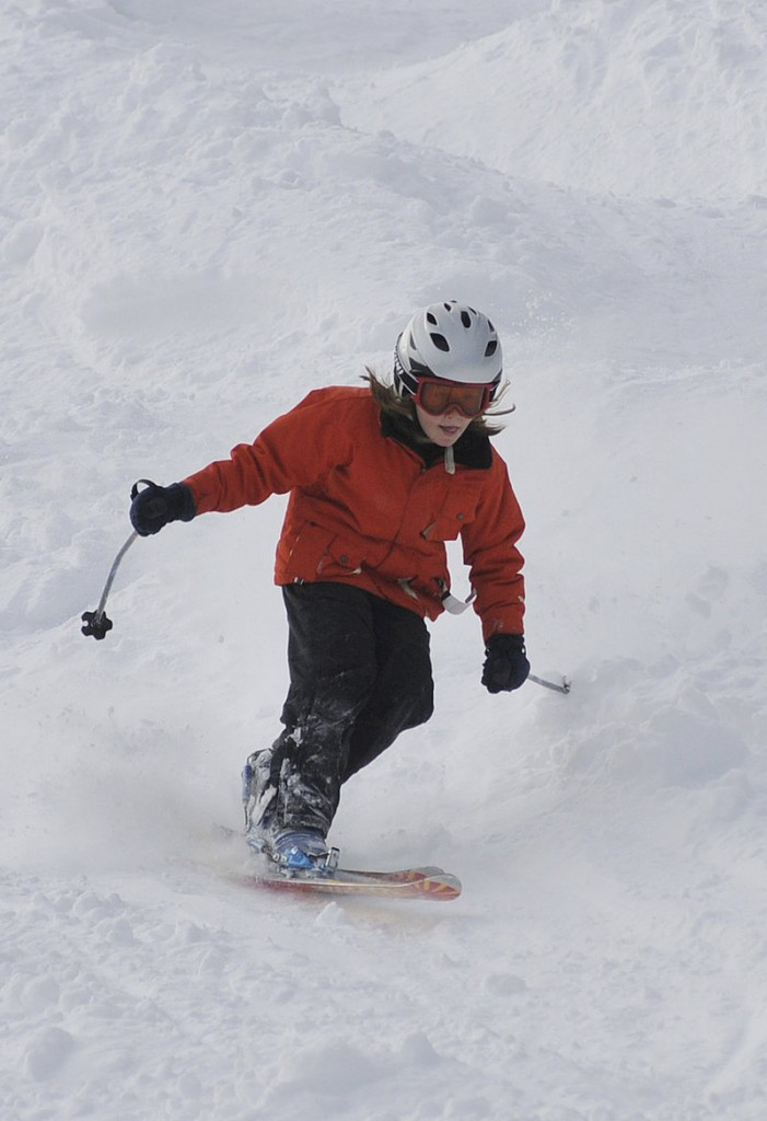 Eight-year-old Myles Barrett of Albany flies along in the mogul competition.