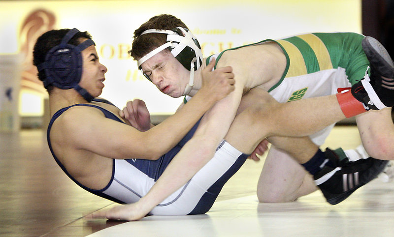 Lucas Dion, right, of Massabesic takes down Kidayer Aljubyly of Portland during their 112-pound consolation-round meeting. Dion won the match with a pin.