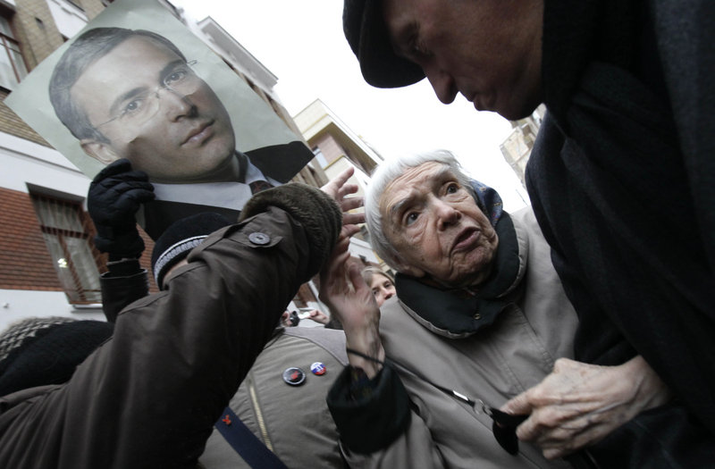 Human rights activist Lyudmila Alexeyeva and other supporters of Mikhail Khodorkovsky gather in Moscow Dec. 27, before the former oil tycoon was sentenced to prison for money laundering. Alexeyeva earlier called on U.S. officials to question the presence in the United States of Ashot Egiazaryan, but she said Sunday that she is now unsure of the facts behind her criticism of him.