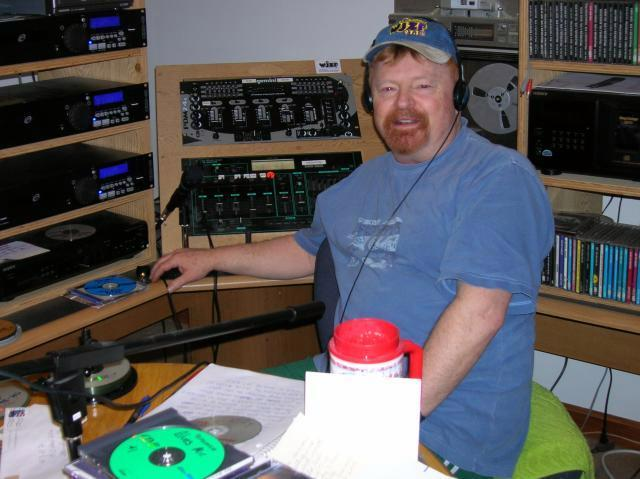 Dave Paterson, station manager for WJZF 97.1 FM, works at his Standish studio. Patterson urges community groups to inquire about free air time on the station, now in its sixth year.