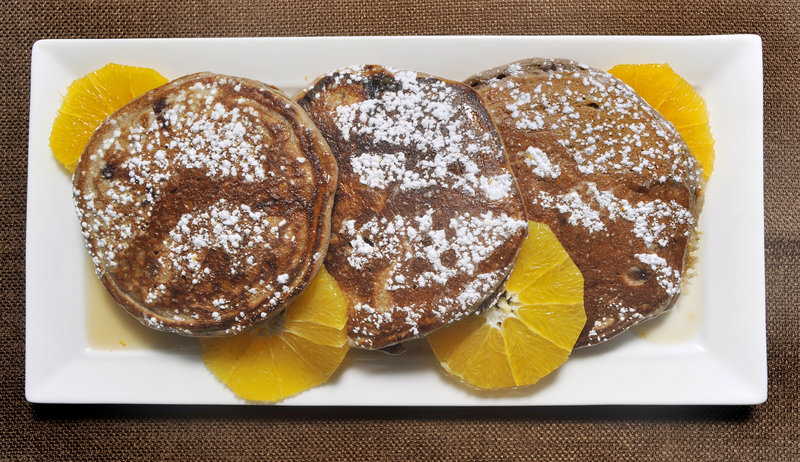 Dana Moos Chocolate Ricotta Pancakes are the little black dress of breakfast foods. They can be dressed up into an adult version with Grand Marnier syrup.