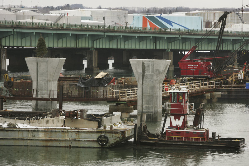 Construction proceeds on the new Veterans Memorial Bridge over the Fore River. Periodic lane closures on the old bridge will start Wednesday.