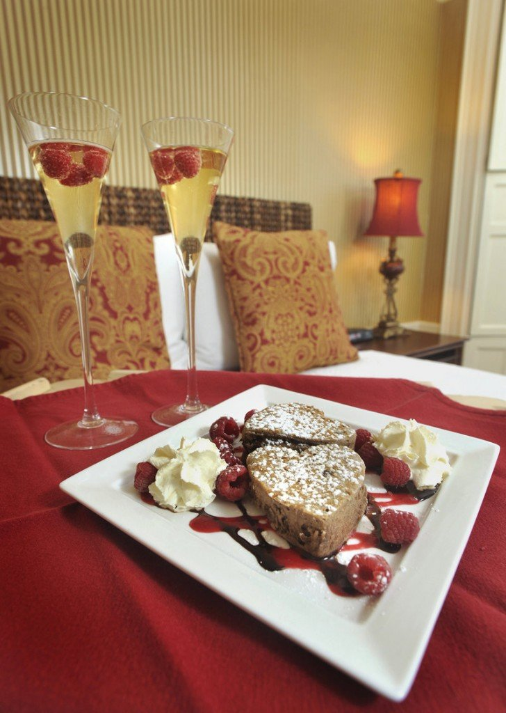Dana Moos' Chocolate Ricotta Pancakes in a family-friendly version with chocolate sauce, raspberry coulis and whipped cream.