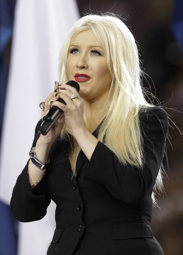 Christina Aguilera sings the national anthem before the Super Bowl game between Green Bay and Pittsburgh on Sunday in Arlington, Texas.