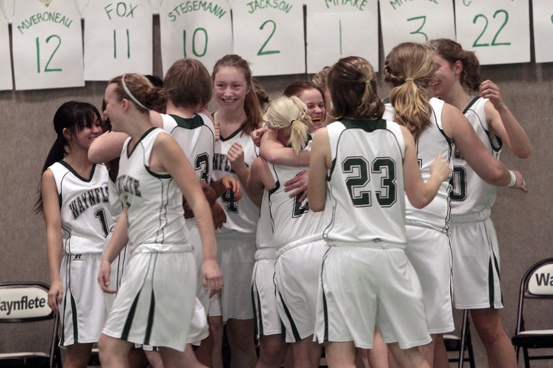 The Waynflete girls' basketball team celebrates after defeating Cape Elizabeth 43-37 at Waynflete on Monday. Lydia Stegemann scored 20 points to propel the Class C Flyers (14-3) past the Class B Capers.