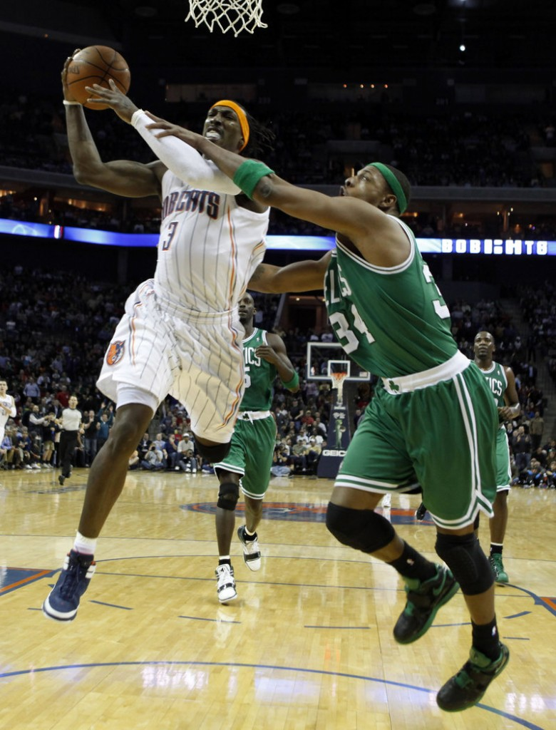 Gerald Wallace drives past Boston's Paul Pierce in the first half of the Bobcats' 94-89 win Monday. Ray Allen hit a pair of 3-pointers and is one short of tying the career mark set by Reggie Miller.