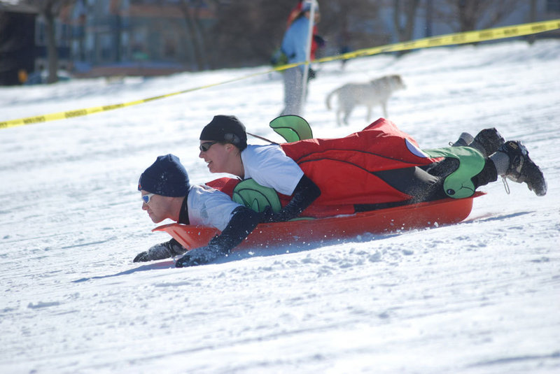 Costumed teammates sled to the finish on the Eastern Promenade in the 2009 Snowman Adventure Race. This year's biking, running and sledding relay is on Saturday.