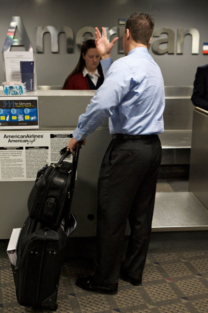 Business traveler Brian Shenberg, a salesman from Chicago, checks in at the Bob Hope Airport in Burbank, Calif. U.S. companies are forecast to spend 5 percent more on travel in 2011 than they did the year before. That's double the growth rate from 2010.