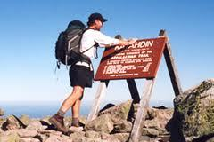 Baxter Peak atop Mount Katahdin marks the northern end of the Appalachian Trail. It takes most through-hikers five to six months of steady walking to complete the whole trail.
