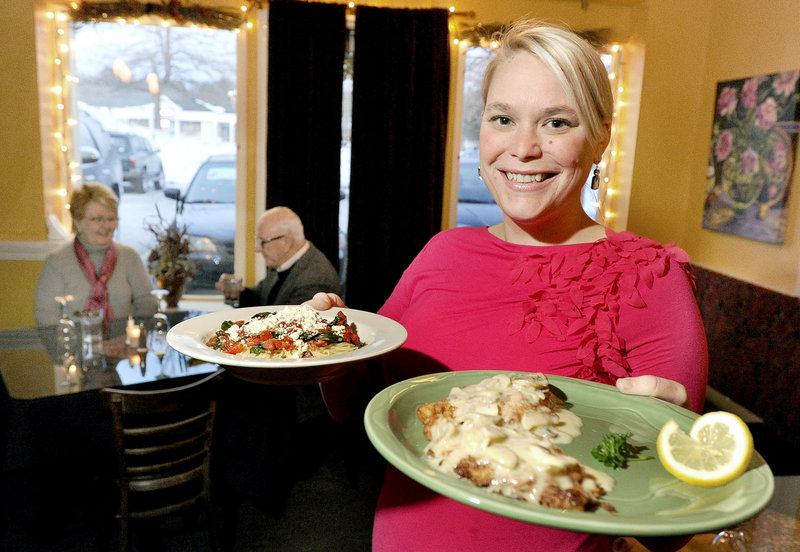 Meg McKissock serves Amatriciana and chicken limone at Hug's Italian Restaurant in Falmouth. Many of Hug's dishes hold cream sauces, one reason for the business's popularity.
