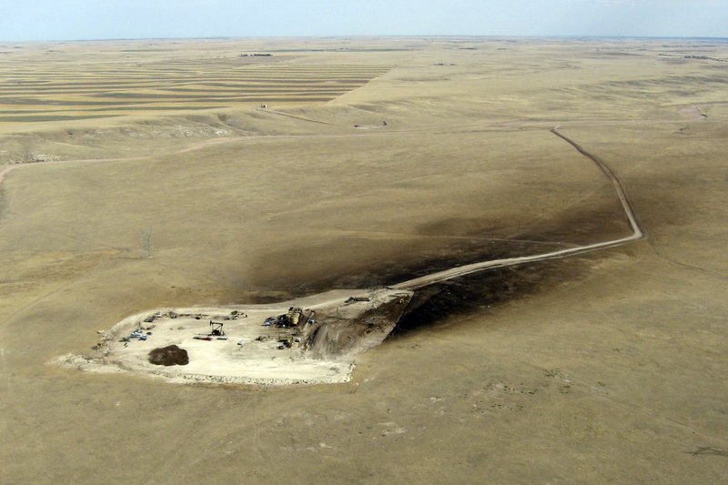 This aerial photo from last fall shows oil sprayed over 15 acres downwind of a runaway oil well owned by SM Energy Co. The well, 12 miles east of Cheyenne, Wyo., was among the first drilled in a rush to tap the Niobrara shale underlying Colorado, Wyoming and Nebraska.