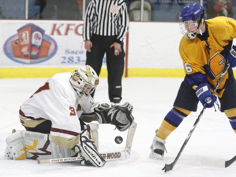 Thornton Academy goaltender Joe Ferrante stops a deflection off the stick of Andre Clement of Falmouth during Thornton's 7-3 victory Wednesday night at the Biddeford Ice Arena. Ferrante finished with 27 saves.