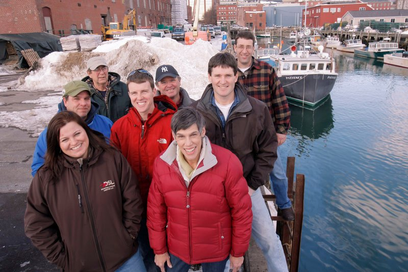 The Calendar Islands Maine Lobster Co. consists of 38 Casco Bay lobstermen who catch the lobsters and sell them as prepared food to upscale markets. They include, from left: Heidi Todd, Mark Olsen, Ernie Burgess, Jeff Legere, Mike Robinson, Emily Lane, Jason Hamilton and John Jordan, president of the company.