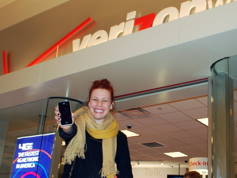 """Madison Bratz shows off the iPhone she bought Thursday at West Acres Mall in Fargo, N.D. """"I have waited so long for this. So long,"""" she said."""
