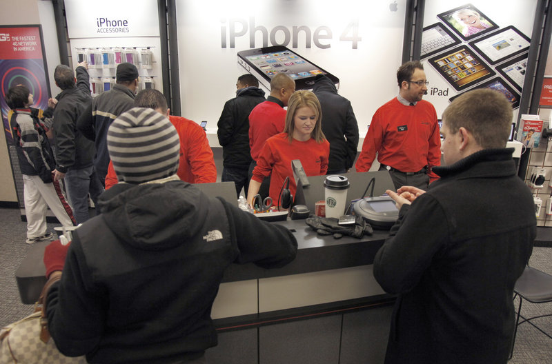 Customers crowd the Verizon Wireless store in Beachwood, Ohio, on Thursday. Until Verizon's arrival, some people were excluded from the iPhone club because of AT&T's exclusive distribution deal and spotty coverage.