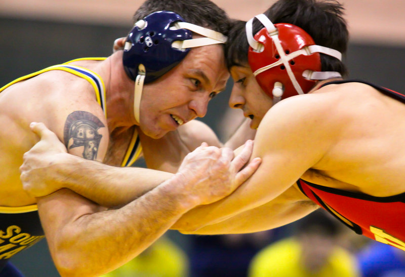 Rick Chipman, left, was one of the state's top wrestlers at Mt. Ararat. Of course, that was more than 20 years ago. Now he's competing at USM, and learning to win all over again.
