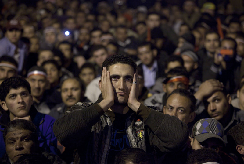 Anti-government protesters watch on a big screen in Tahrir Square in downtown Cairo as Egyptian President Hosni Mubarak makes a televised statement to his nation on Thursday. The throng of protesters reacted in fury and disbelief, as they had expected an end to Mubarak's reign of 30 years.