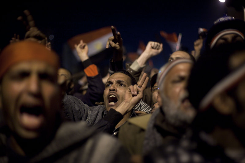 Protesters in Tahrir Square react as Egyptian President Hosni Mubarak makes a televised statement to the nation Thursday.