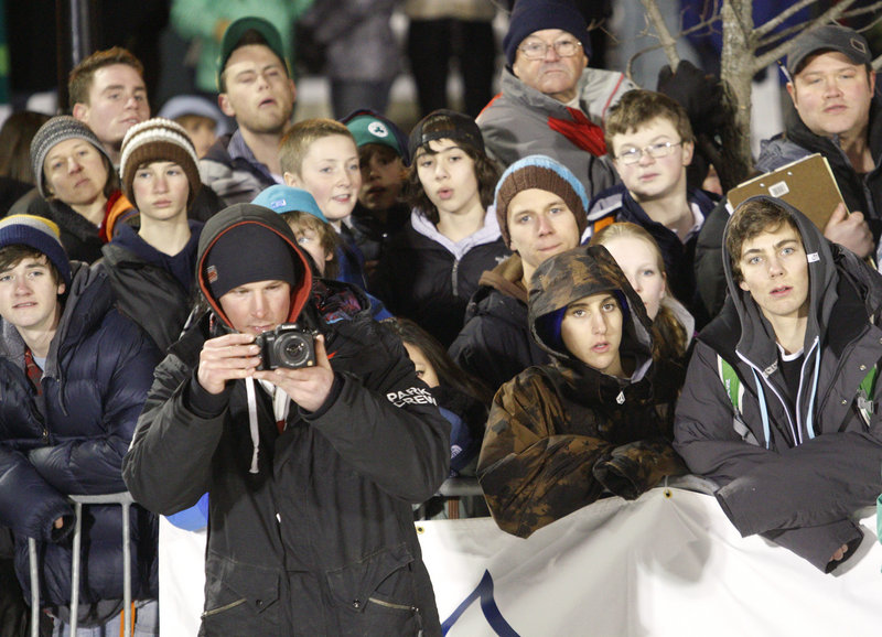 A large crowd braves the cold to watch the winter sports action.