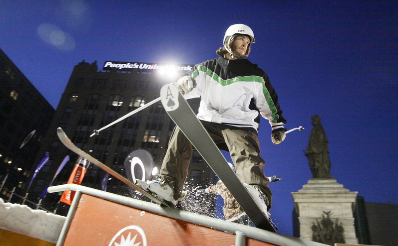 Dan Jones, a skier from Sunapee, N.H., slides down a rail during the third annual Downtown Showdown in Monument Square on Friday night.
