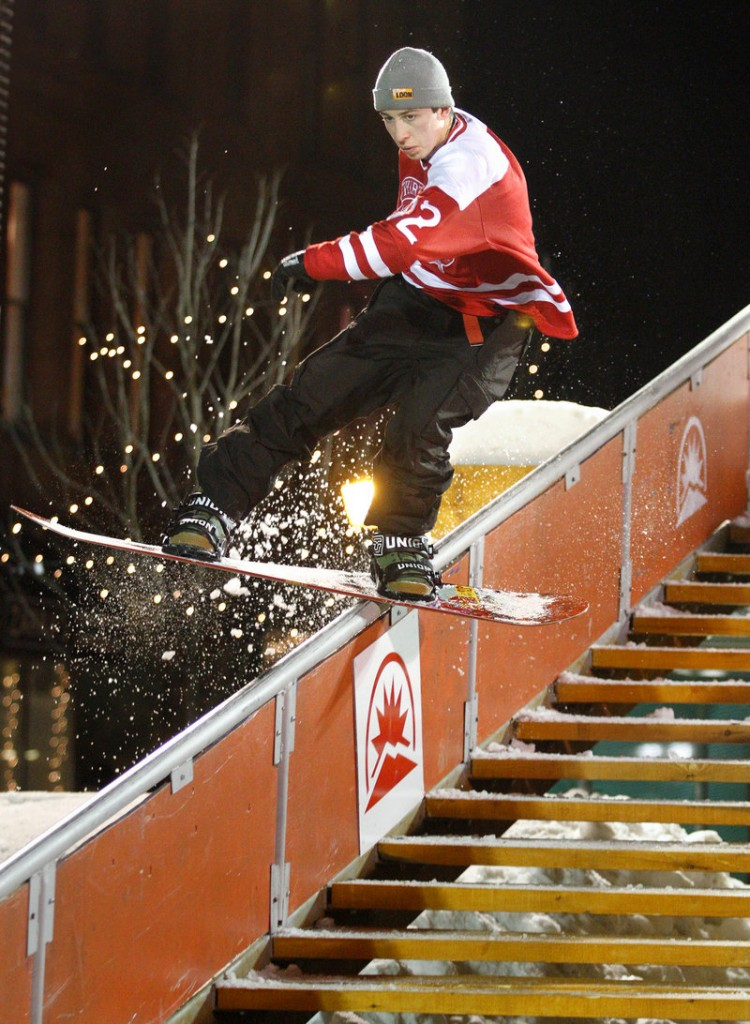 Snowboarder Mike Ravelson of Shrewsbury, Mass., rides a rail during the third annual Downtown Showdown in Monument Square on Friday night. The event drew an estimated 2,000 people.
