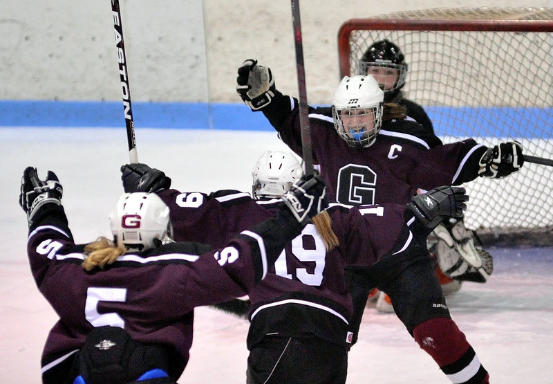 Michaela Finnegan of Greely prepares to welcome her teammates Friday night after scoring the first goal of a 3-2 victory against Winslow in an Eastern semifinal.